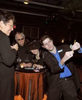 Performing close-up magic at a fundraising event.